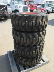 (4) 12-16.5 Bobcat Skid Steer Tires On Wheels