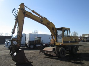 1995 Caterpillar 214BFT Rubber Tire Excavator