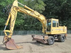 1991 Caterpillar 214BFT Rubber Tire Excavator